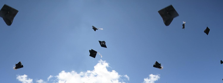 Graduation caps tossed in the air