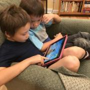 Koji Dennis (left) and Niko Dennis are engrossed in a PhET simulation for iPad. Photo by Kathy Perkins.