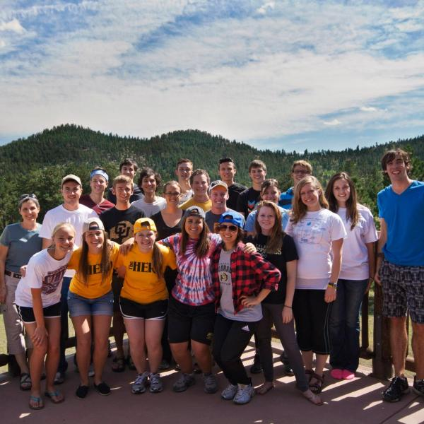 PLC students pose for a group picture on the deck at Highlands Camp