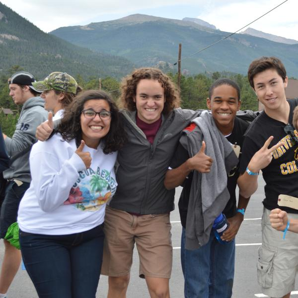 Orientation leaders and staff member, Ryan Dewey, display their enthusiasm for arriving at the Rocky Mountain YMCA in Estes Park