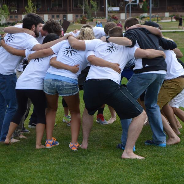 The student staff huddle up to talk kick-ball strategy versus the first-year team