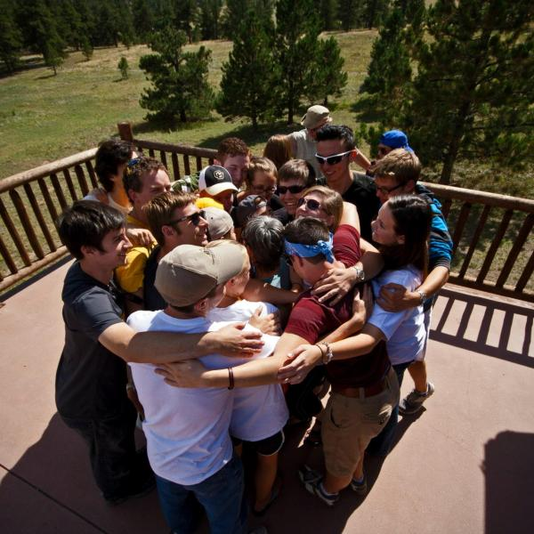 Students give one another a group hug