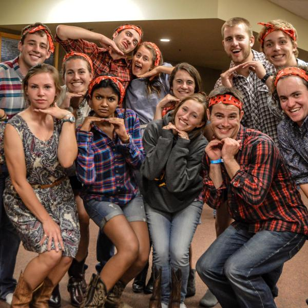 The student staff poses in their square dancing outfits