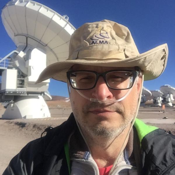 Joe visiting the Atacama Large Millimeter Array (almaobservatory.org), at 16,700 feet elevation.