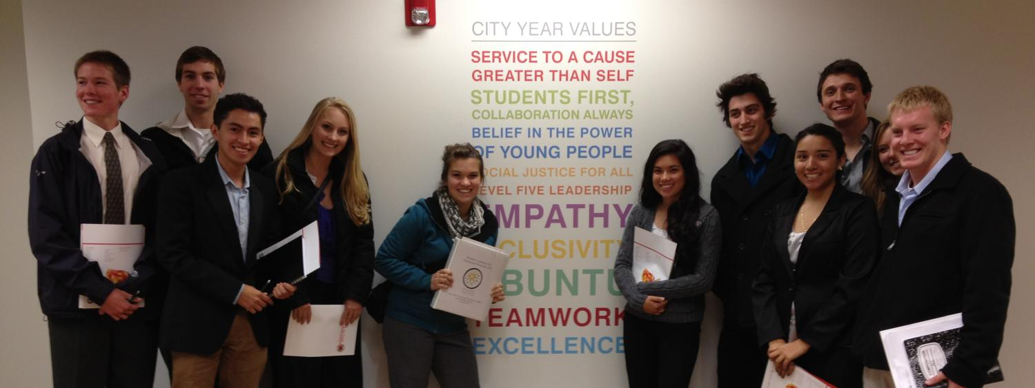 PLC students stand in front of the City Year Values wall art during Education Weekend