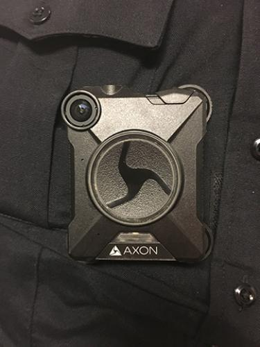 An Axon body-worn camera worn by a officer
