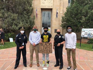 Chief Herold, DA Dougherty and Chief Jokerst with CU Boulder students who organized the march.
