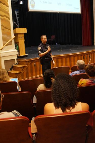 A CUPD officer teaches an active harmer response class to CU Boulder affiliates