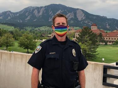 Officer Rossi wears a rainbow mask during the Coronavirus pandemic.