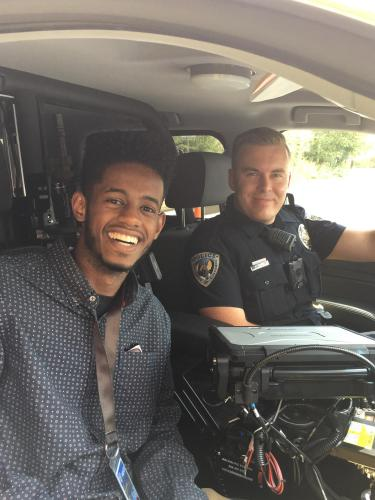 A student during a ride along with a CU Boulder officer