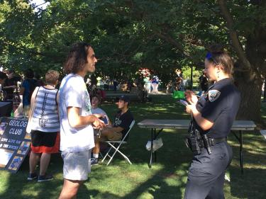 An officer takes a report from a student on the CU Boulder campus