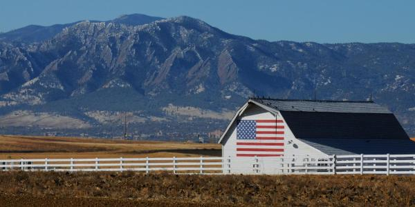 American flag painted on a barn outside of Boulder