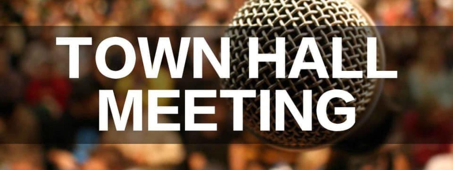 Image of town hall meeting sign with microphone