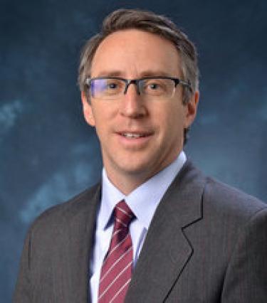 E. Scott Adler
