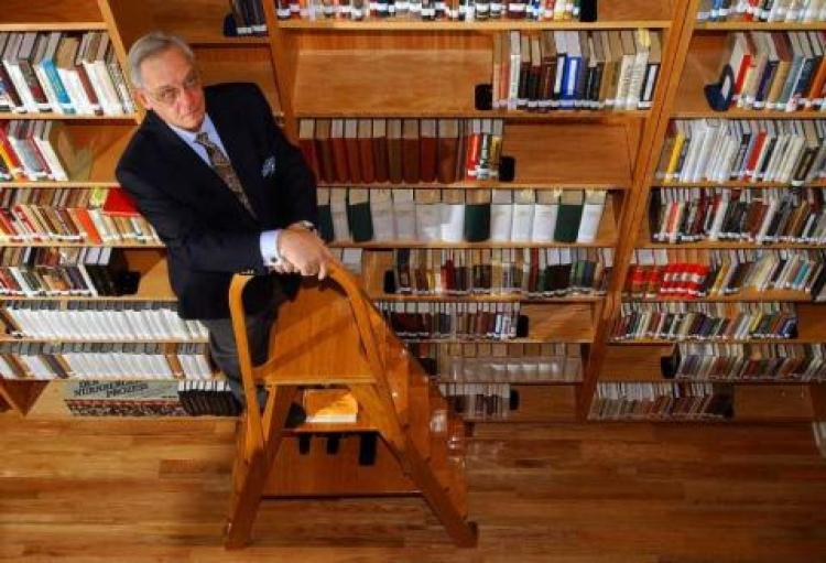 Harry Mazal on a ladder in his library