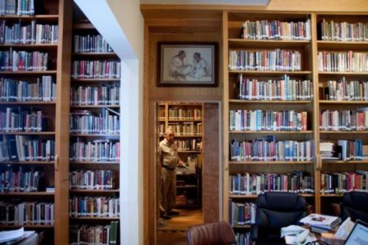 Harry Mazal pictured with part of his Holocaust library in Texas