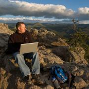 Man on Flagstaff with computer