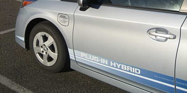 A hybrid electric car parked outside the Engineering Center.