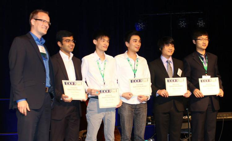Saad Pervaiz (second from left) accepts his award
