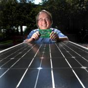 Bob Erickson with solar panel