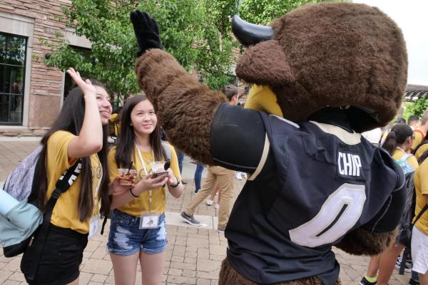 Students high-fiving Chip