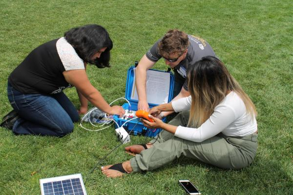 STEM students working on a project outside
