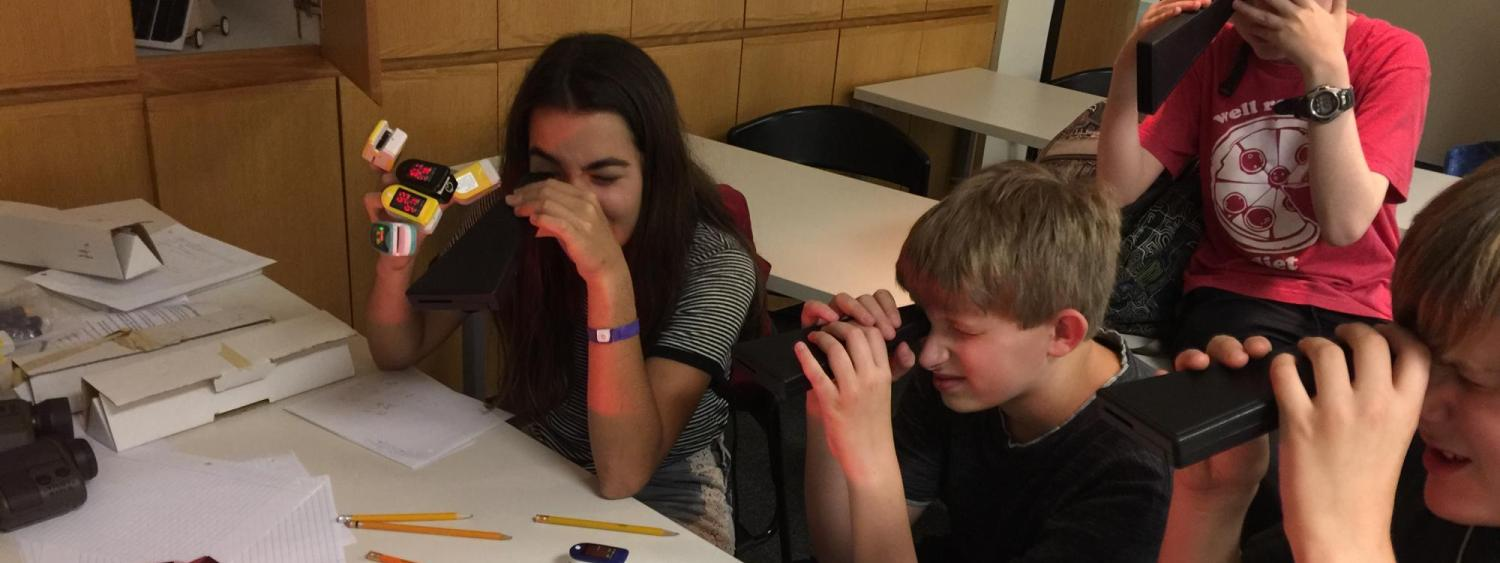 Student experimenting with UV light