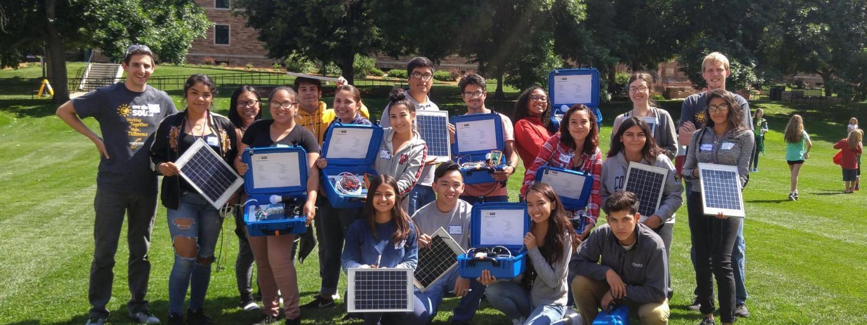 STEM participants building solar suitcases