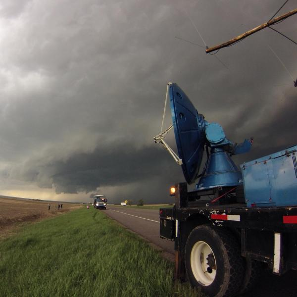 Two Doppler On Wheels (DOW) mobile radars scanning a supercell thunderstorm on the plains of Colorado on 21 May 2014. The DOWs are part of the Center for Severe Weather Research (CSWR) facility, and their goal is to collect radar and wind data on low-level tornado environments.