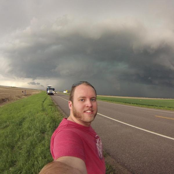 "A selfie with a supercell thunderstorm and a Doppler On Wheels (DOW) mobile radar as we wait to see if a tornado will form. The goal was to place tornado ""pods"" in front of any tornado that forms while collecting radar data at the same time."