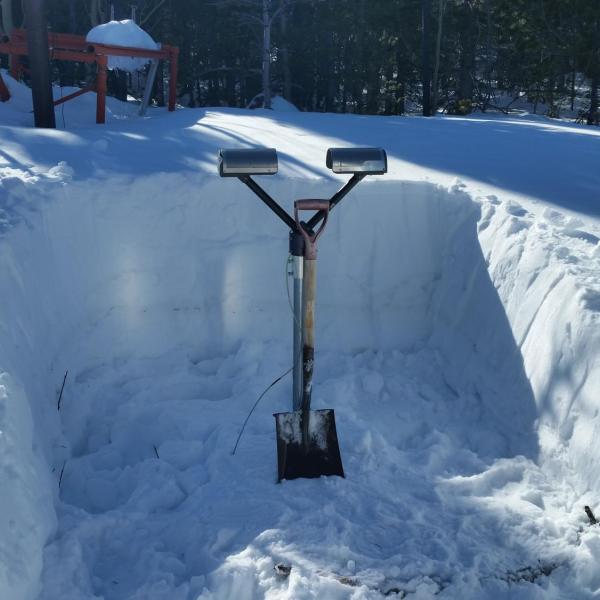 Digging out a PARSIVEL disdrometer at the C-1 research site (10,000 ft elevation) at Niwot Ridge, Colorado on 8 March 2015. The snow drifts heavily in this area during the winter and spring, so it usually needs dug out every spring.