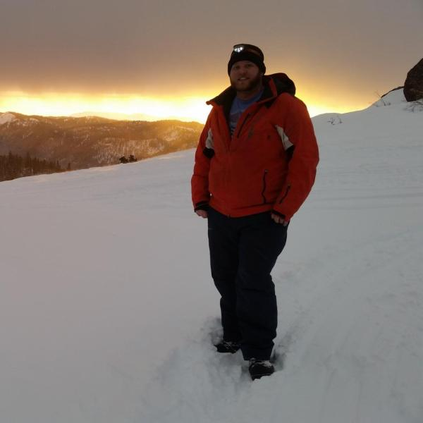 Graduate student Josh Aikins enjoying a mountaintop sunset from the Packer John location (7,000 ft elevation) in central Idaho on 30 January 2017 prior to an incoming storm. Josh was deployed on this mountaintop location between January and March 2017 as part of the SNOWIE field project, which aimed to observe the impacts of cloud seeding on snow production within the Payette River Basin of Idaho.