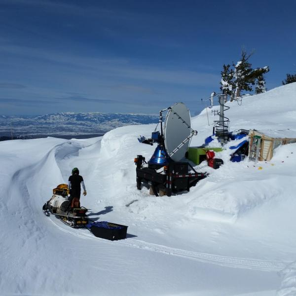 A CSWR Doppler On Wheels (DOW) mobile radar positioned at the Snowbank mountaintop location (8,000 ft elevation) on 12 March 2017 as part of the SNOWIE field project. The DOW radar was used to collect data on seeded and natural clouds and snowfall between January and March 2017. The only access to the site was via snowmobile. The site was so buried by snow that tunnels were dug to access the trailer, porta potties, and radar truck.