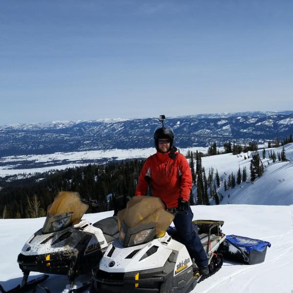 CU graduate student Josh Aikins snowmobiling to the Snowbank research site in central Idaho during the SNOWIE field project on 12 March 2017. The SNOWIE project ran between January and March 2017 and included manning two mountaintop mobile radars to collect data on the impacts of cloud seeding on mountain snowpack. This was one of Josh's daily commutes during the project.