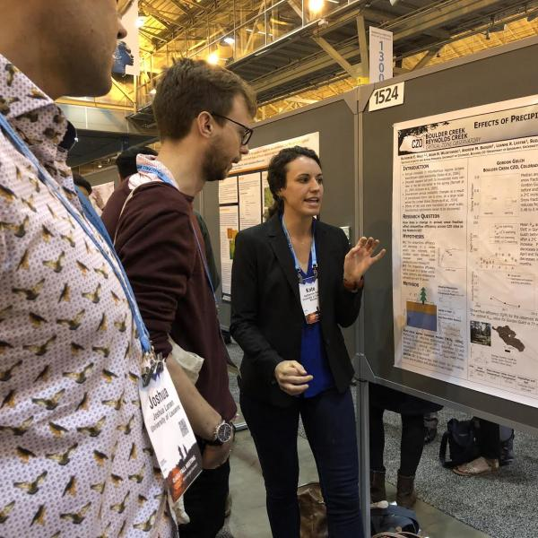 Graduate student Katherine Hale presenting work in poster form during the 2017 AGU conference in New Orleans.
