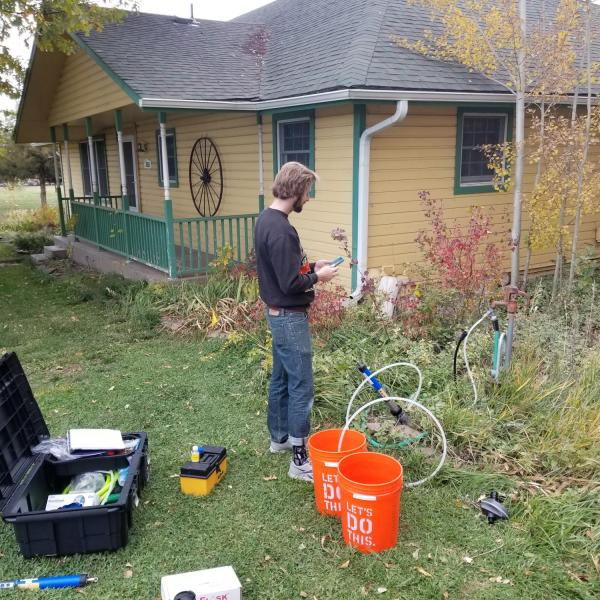 Graduate student, John Stults, working on a well water project in east Boulder County.