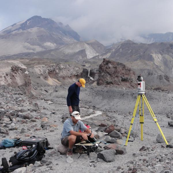 Faculty member John Pitlick and UNAVCO engineer Jim Normadeau using ground-based LiDAR to scan the topography of the North Fork Toutle River near Mount St. Helens, WA. Aug. 2010.