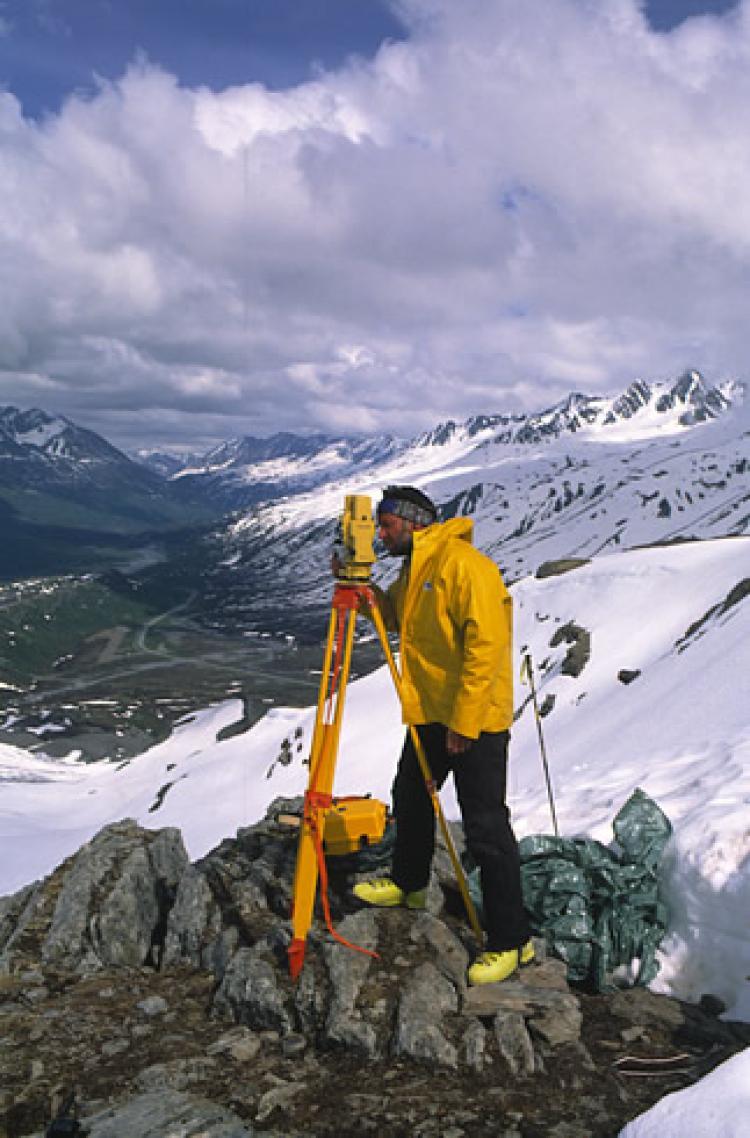 Tad Pfeffer (CEAE & INSTAAR) surveying the Worthington Glacier, Alaska, 1993