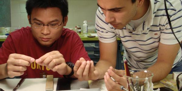 Two students working on a physics project