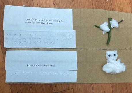 page with braille text and a tactile tree, and a snowman