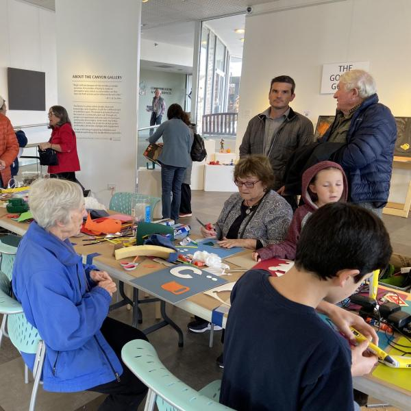Visitors working on the tactile alphabet