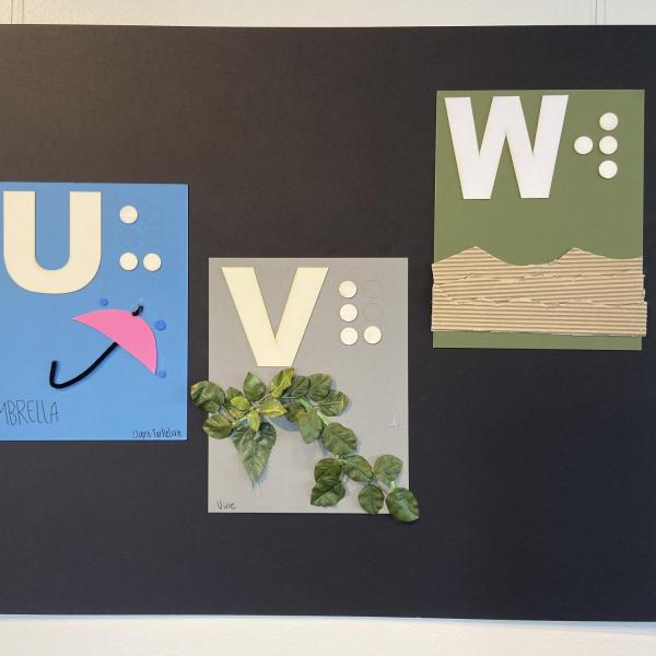 Alphabet panels for letters U,V,W showing an umbrella, vine, and water.