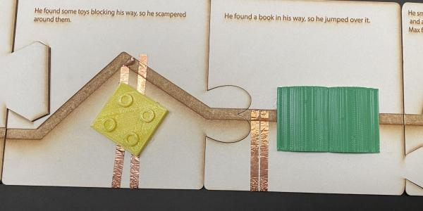 Story showing path going around a toy block and with a book covering path.