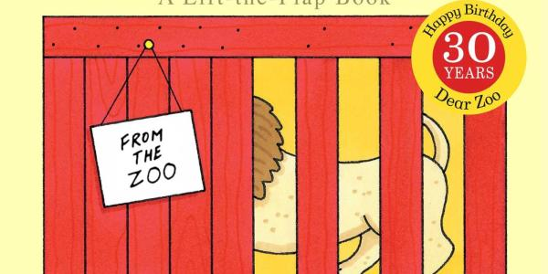 Book cover for Dear Zoo showing a crate with part of a lion showing.