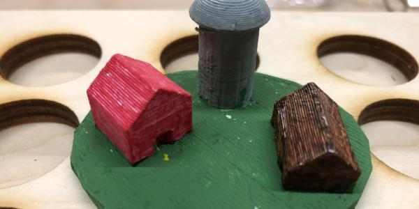 3D printed barn, silo, and cabin for Enchanted Forest board game.
