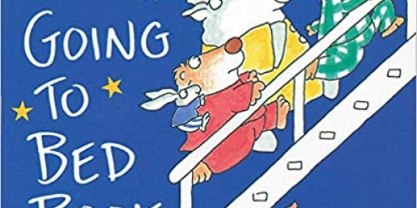 Book cover of The Going to Bed Book by Sandra Boynton with animals dressed in pajamas running upstairs to bed.