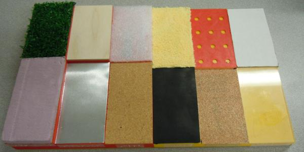 Xylophone shaped board with different texture swatches.