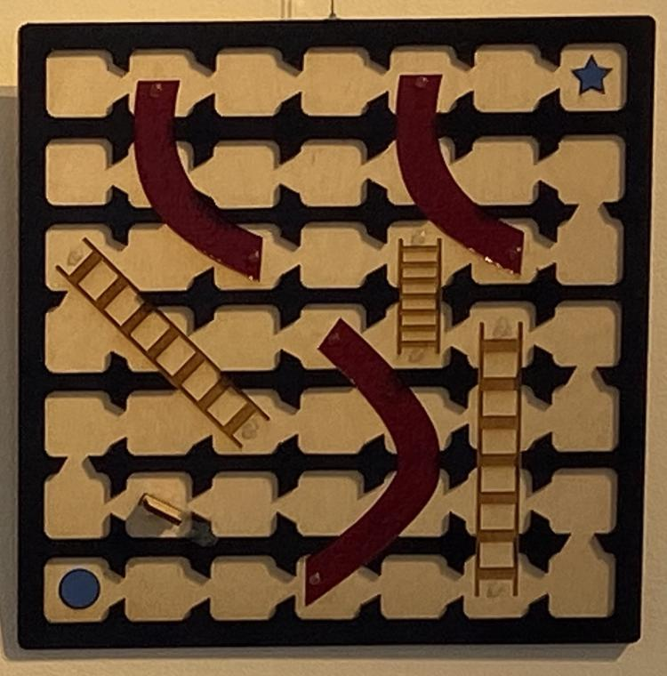 Tactile gameboard for Chutes and Ladders with high contrast colors.