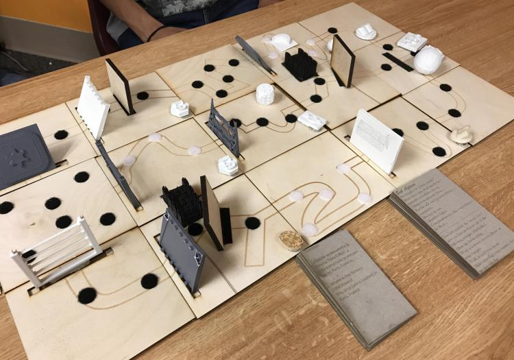 Tactile board game using laser cut pieces