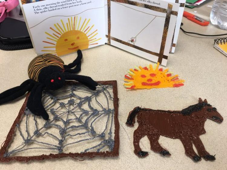 Spider puppet and 3D pen drawings of spider web and horse.